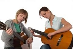 teaching how to play guitar